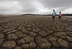 A family negotiates their way around a dried-up section of the Theewaterskloof dam near Cape Town.