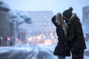 A couple kiss in front of the Colosseum covered by snow during a snowfall in Rome, Italy. Schools and public offices were closed and snow-removal crews were in place as Rome was on high alert for a first winter blast.