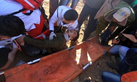 At least two Palestinians were killed Friday when Israeli warplanes struck Hamas positions in the blockaded Gaza Strip. Israel says the strikes were in response to gunfire from souther Gaza that wounded two Israeli soldiers.