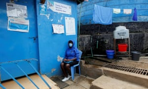 Bosibori waits to be seen at the Shofco health centre where she attends her antenatal clinic appointment.