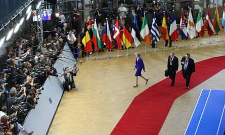 Theresa May speaks to journalist before European Union summit in Brussels.