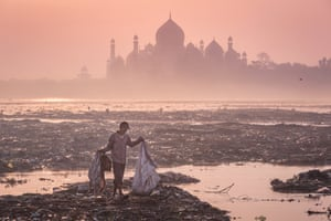 Behind the Taj Mahal, India, by Mustafa AbdulHadi The early morning silhouette of Taj forms a backdrop to a garbage-strewn bank of the Yamuna river in Agra where a man scans the rubbish for valuables.