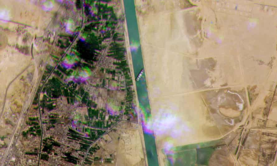A satellite image showing the Ever Given lodged sideways across the waterway of Egypt's Suez Canal