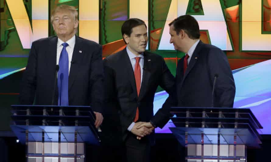 Marco Rubio and Ted Cruz shake hands while Donald Trump stands by