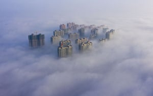 Yuncheng City, China. Top floors of buildings protrude through dense fog in Shanxi province