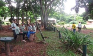 Students sit in the shade at the Mbaracayú Education Centre.