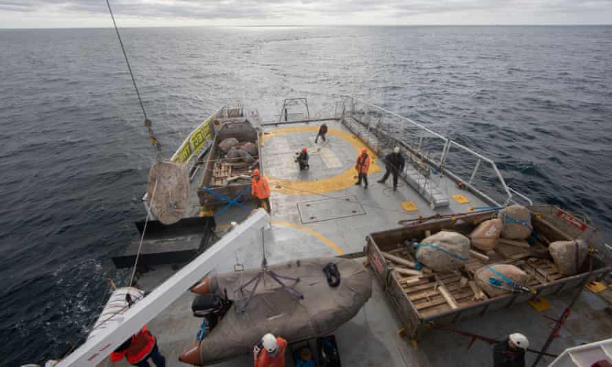 Boulders being lowered into the Dogger Bank MPA from the Greenpeace ship, Esperanza.