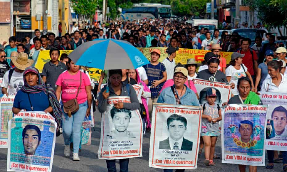 Relatives of the 43 missing students march the day after of the fifth anniversary of their disappearance, in Iguala, 27 September 2019.