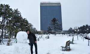 Alek Sigley posing with a snowman on the campus of Kim Il-Sung University, Pyongyang