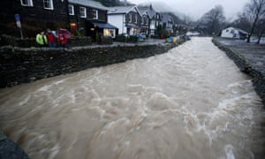 Rising floodwaters in Glenridding, Ullswater. The historical approach has been to get water from the hills to the sea as quickly as possible, but MPs say more natural measures are needed to slow the flow of water.