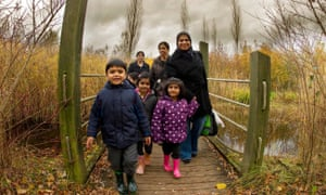 Family walking down path at Conkers, Visitor Centre