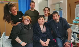 Sally Morgan-Moore and Paige Harvey from Frontier Developments, left, visit Michael and family in Addenbrooke's hospital. Pictures reproduced with permission.