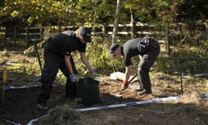 Police officers work in soil