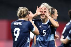 White celebrates with teammate Houghton.
