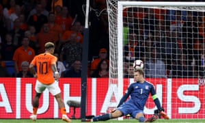 Memphis Depay of the Netherlands scores his sides second goal.