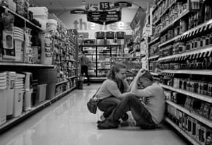 Rachel Lloyd comforting her husband Paul who has had a flashback. While looking for light bulbs in the supermarket near his home in Salt Lake City, he stopped to smell a scented candle