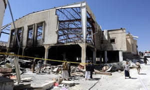 Yemeni people inspect a funeral hall  in Sana'a destroyed by a Saudi-led coalition airstrike