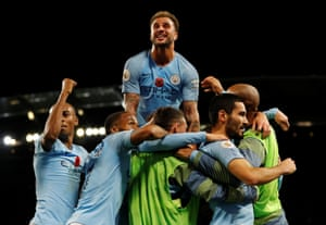 Manchester City's Ilkay Gundogan celebrates scoring their third goal with teammates