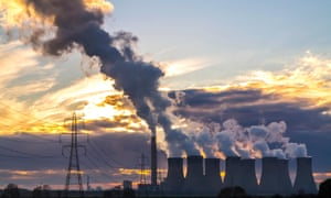 Drax Power station emits large amounts of pollution against a setting sun