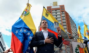 Juan Guaidó declares himself the country's 'acting president' during a rally on Wednesday.