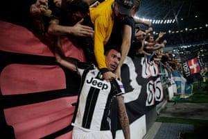 Mandzukic celebrates with the Juve fans.