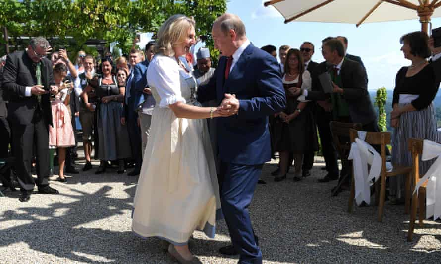 Austrian foreign minister Karin Kneissl and Russian President Vladimir Putin dance at her wedding.