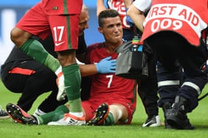 Ronaldo reacts as medics arrive on the pitch to help him off.