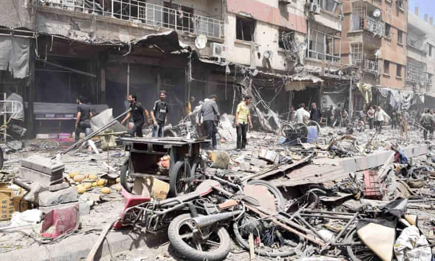 Destroyed buildings and possessions at a market in Douma, Syria.
