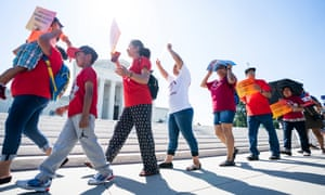 Immigration activists gather outside the US Supreme Court to await the justices' ruling on the Trump administration's attempt to add a citizenship question to the US census in Washington DC, on 27 June.