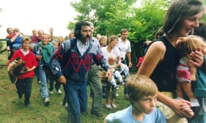 East Germans rush across the border from Hungary to Austria near the town of Moerbisch am See on 19 August 1989.