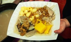 Rotten luck ? € | a dish of fermented skata at a restaurant in Reykjavik.