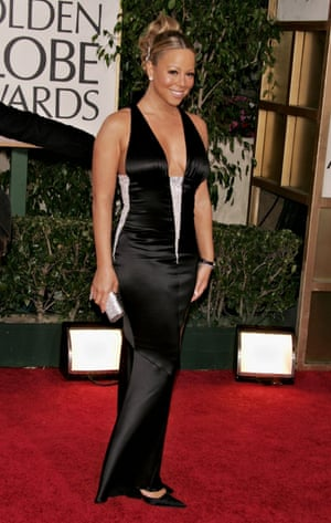 Wearing a dress designed by friend Karl Lagerfeld at the Golden Globe Awards 2006.