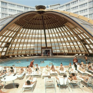 Guests are served cocktails beside the dome-covered pool at the International Inn Hotel in Washington DC, 1963