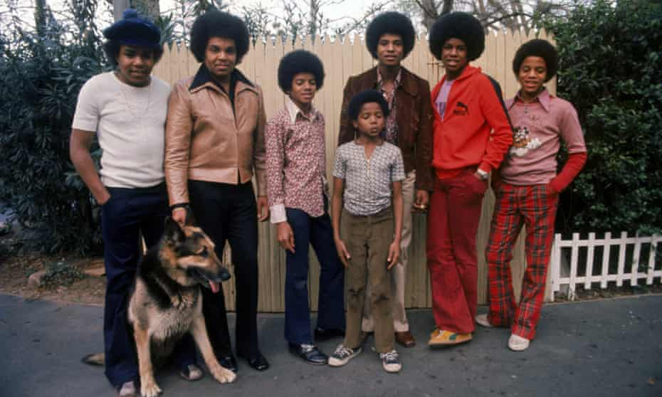 The Jacksons with their father Joe in their backyard (l to r) Tito, Joe, Michael, Randy, Jackie, Jermaine and Marlon.