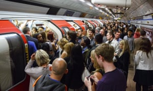 Commuters queuing for tube trains at Green Park Tube Station