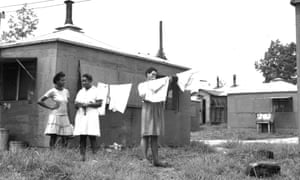 African American women hanging laundry in a hutment area, Oak Ridge, 1945. Despite their often forward-looking design and planning, the three Secret Cities of the Manhattan Project treated racial segregation as a given.