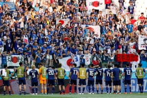 Japan celebrate their group-stage progression with their fans