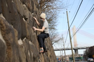 """Garrett Carroll, 31-years-old, climbs the wall on the other side of Calvary Cemetery in Queens, New York. """"I usually go to Brooklyn Boulders, but it's now closed. I live in the neighborhood and I got the idea when walking by this wall with my girlfriend within the last two weeks. This is my third time climbing here. I have a hang board to practice at home, but this is good for the outdoors. I have seen one other person doing it here."""""""