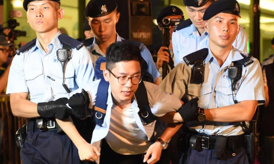 Nathan Law was detained by police last month during a protest against celebrations to mark the anniversary of the 1997 handover of Hong Kong to China.