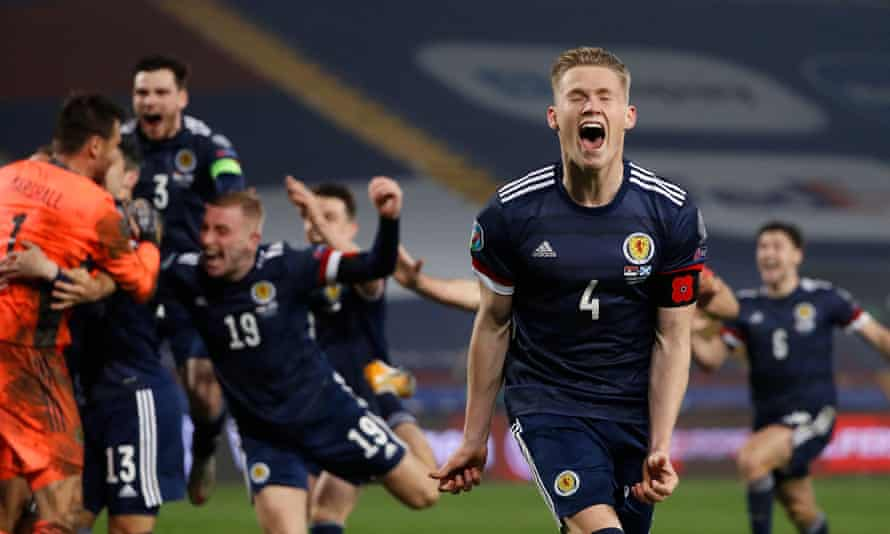 Scott McTominay (No 4) and his Scotland teammates celebrate with David Marshall after the penalty shootout win in Belgrade.