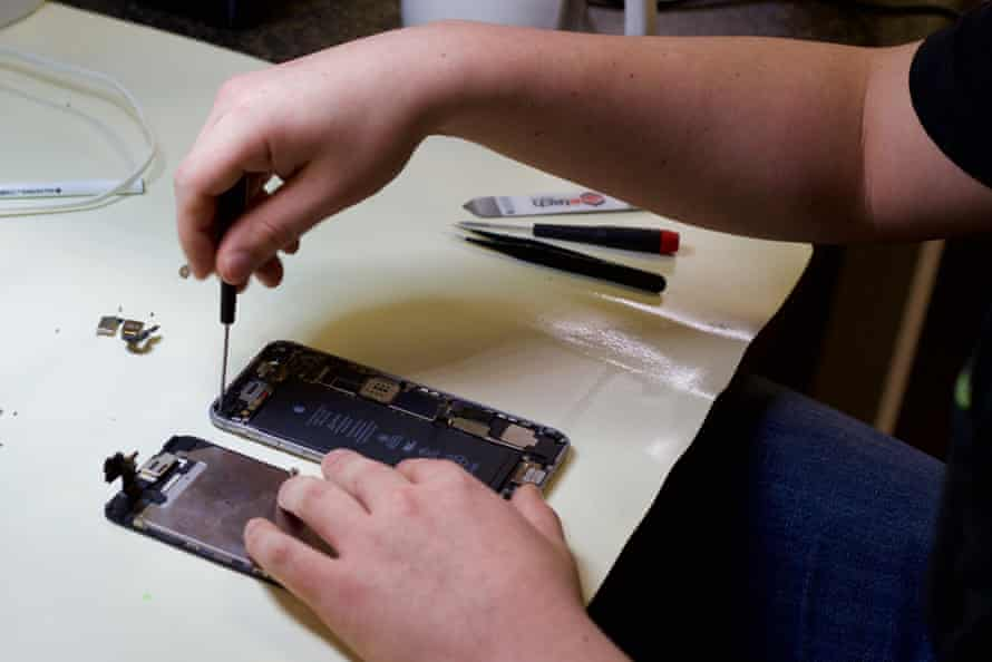 One of iFixOmaha's technicians treating a water-damaged iPhone 6.