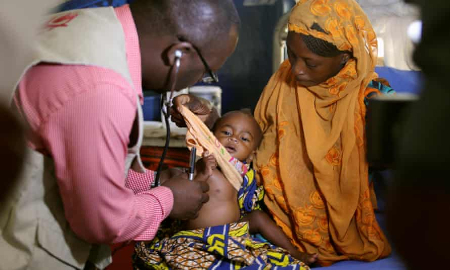 A doctor examines a malnourished baby in Maiduguri, 30 November 2016