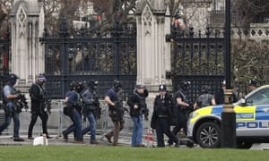 Armed police officers enter the Houses of Parliament