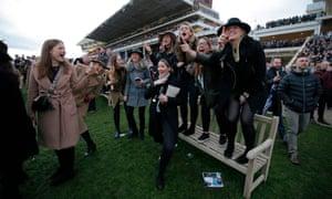 Spectators cheer on the runners in the final race of the 2019 Cheltenham Festival.