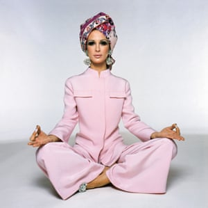 A model in palazzo pyjamas and a printed silk turban embroidered with Swarovski crystals, from the Pucci autumn/winter 1969 collection.