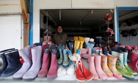 A shoe seller in the Zaatari refugee camp.