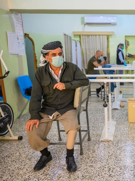 A man wearing prosthetic leg in the Red Cross rehabilitation centre, Erbil, Kurdistan, northern Iraq.