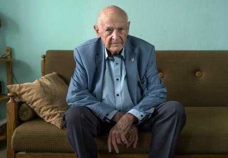 Marek Dunin-Wasowicz sitting on a sofa looking at the camera