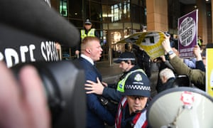 United Patriots Front leader Blair Cottrell (left) confronts antifascist protesters outside the Melbourne magistrates court where he faced racial vilification charges brought after protests in Bendigo