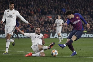 Real Madrid's Dani Carvajal dives to block a shot by Barcelona's Alena.
